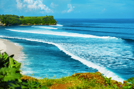 nature scenery: Nature Landscape Background. Scenic View Of Beautiful Paradise Island Coast With Green Cliffs, Waves On Sea And Clear Blue Sky Over Ocean Horizon. Tropical Seascape Scenery, Coastline. Summer Travel