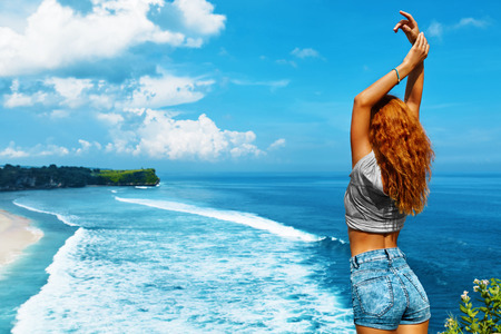 Summer Travel Holidays Vacation. Beautiful Happy Free Woman With Fit Body Enjoying Nature Beauty At Sea Beach. Cheerful Healthy Girl With Hands Up Relaxing Outdoor By Ocean. Freedom, Happiness Concept