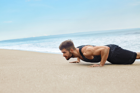 athletic body: Workout Exercise. Closeup Of Healthy Handsome Active Man With Fit Muscular Body Doing Push Ups Exercises. Sporty Athletic Male Exercising At Beach, Training Outdoor. Sports And Fitness Concept