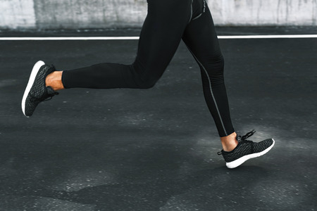 sportwear: Sport. Close Up Of Sporty Male Legs In Sportwear And Sneakers Running On Road. Healthy Active Athletic Runner Man Jogging During Outdoor Workout, Exercising And Training For Marathon. Fitness Concept