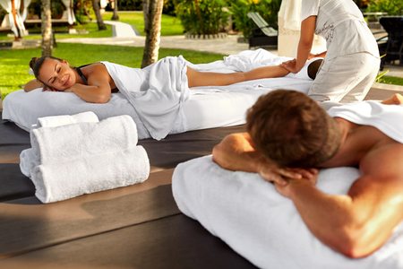 relax massage: Couple Treatment At Spa. People In Love Enjoying Body Massage Outdoors At Day Spa Resort. Beautiful Woman, Handsome Happy Healthy Man Relaxing On Romantic Honeymoon Vacation In Summer. Relax Concept