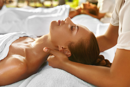 Spa Massage. Closeup Of Beautiful Healthy Happy Smiling Woman Getting Relaxing In Day Spa Salon Outdoors. Masseur Hand Massaging Neck With Aromatherapy Oil. Relax Body Care Beauty Treatment Concept
