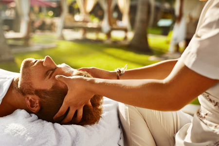head massage: Spa Massage. Closeup Of Beautiful Healthy Happy Man Enjoying Relaxing Head Massage At Outdoor Day Salon. Masseur Hands Massaging Handsome Male Head. Relax Beauty Treatment For Men, Health Care Concept