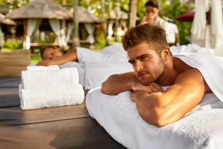 relax massage: Romantic Couple Spa. Closeup Of Handsome Healthy Happy Smiling Man, Beautiful Woman Relaxing At Day Spa Resort. People Enjoying Body Relaxation Massage Outdoors In Summer. Relax Treatment Concept Stock Photo