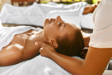 beautiful neck: Spa Massage. Closeup Of Beautiful Healthy Happy Smiling Woman Getting Relaxing In Day Spa Salon Outdoors. Masseur Hand Massaging Neck With Aromatherapy Oil. Relax Body Care Beauty Treatment Concept