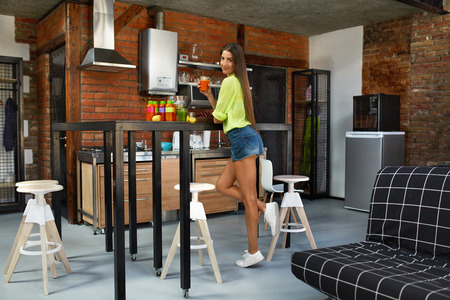 cleanse: Super Food For Healthy Nutrition And Weight Loss Diet. Beautiful Happy Smiling Woman With Fit Body Drinking Fresh Vegetable Detox Juice Smoothie In Kitchen, Enjoying Cleanse Diet Drink At Home