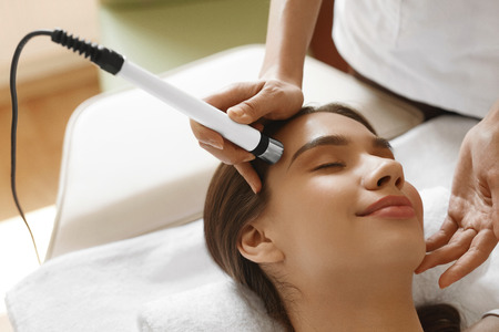 Face Skin Care. Closeup Of Beautiful Woman Getting Oxygen Jet Peeling, Microdermabrasion Treatment At Beauty Salon. Girl Enjoying Skin Cleansing Procedure At Cosmetology Center. High Resolution Image Stock Photo