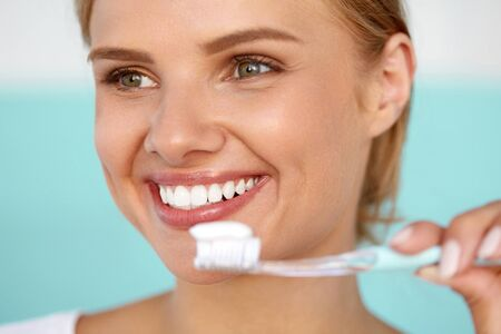 Brushing Teeth. Closeup Beautiful Happy Smiling Woman With Perfect Smile, Healthy White Teeth, Fresh Face Holding Toothbrush With Toothpaste. Oral Hygiene, Dental Health Concept. High Resolution Image