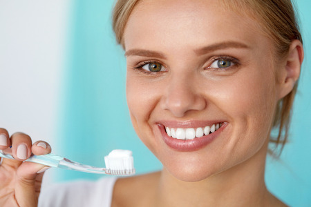 Dental Care. Closeup Of Beautiful Smiling Woman With Perfect Smile, Healthy White Teeth And Fresh Face With Toothbrush, Toothpaste In Hand. Mouth Hygiene, Oral Health Concept. High Resolution Image Stock Photo