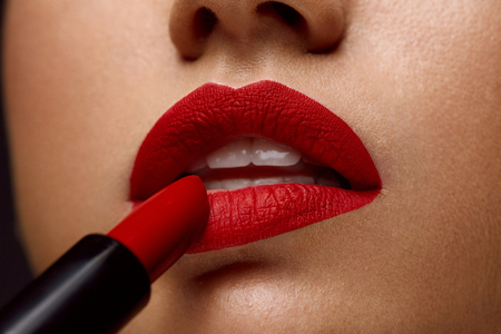 full lips: Red Lipstick. Closeup Of Woman Face With Bright Red Matte Lipstick On Full Lips. Beautiful Girl Applying Rouge Lipstick OnmSexy Soft Plump Lip. Beauty Cosmetics, Makeup Concept. High Resolution Image