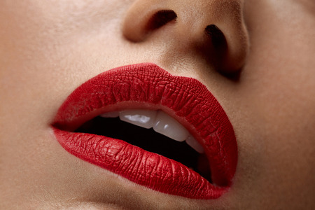 sexy young girls: Woman Lips With Red Lipstick. Closeup Beautiful Young Sexy Girls Mouth With Cosmetic Lipstick On Plump Full Lips. Female With Professional Lip Makeup. Beauty Cosmetics Concept. High Resolution Image