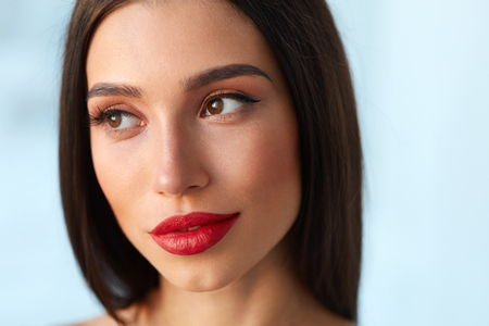 woman portrait: Fashion Beauty Woman Portrait. Closeup Of Beautiful Fashionable Young Woman Face With Perfect Makeup, Long Eyelashes, Smooth Skin And Red Lipstick On Full Sexy Lips. Cosmetics Concept. High Resolution