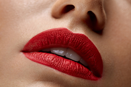 Woman Lips With Red Lipstick. Closeup Beautiful Young Sexy Girl's Mouth With Cosmetic Lipstick On Plump Full Lips. Female With Professional Lip Makeup. Beauty Cosmetics Concept. High Resolution Image Archivio Fotografico