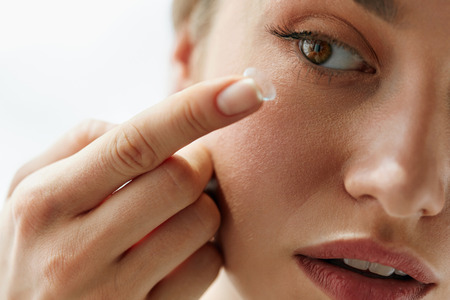 Contact Lens For Vision. Closeup Of Female Face With Applying Contact Lens On Her Brown Eyes. Beautiful Woman Putting Eye Lenses With Hands. Opthalmology Medicine And Health. High Resolution  Stock Photo
