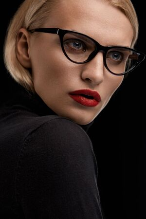 eye red: Fashion Makeup Model With Red Lips And Black Eye Glasses. Beautiful Woman Face With Sexy Red Lipstick And Retro Design Eyewear. Female Wearing Optical Eyeglasses Frame. Beauty Concept. High Resolution Stock Photo