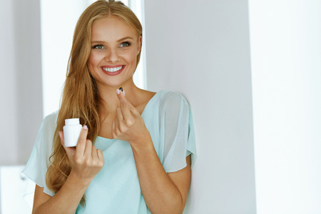 Woman Taking Medicine. Beautiful Smiling Girl Taking Medication, Holding Bottle With Pills In Hand. Healthy Happy Female Eating Pill. Vitamins And Supplements, Diet Nutrition Concept. High Resolution