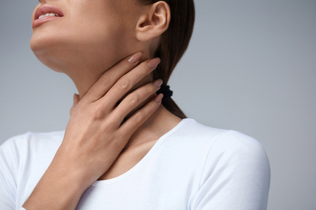 beautiful neck: Throat Pain. Closeup Of Sick Woman With Sore Throat Feeling Bad, Suffering From Painful Swallowing. Beautiful Girl Touching Neck With Hand. Illness, Health Care And Medicine Concepts. High Resolution