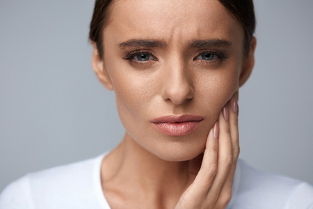 Teeth Problem. Woman Feeling Tooth Pain. Closeup Of Beautiful Sad Girl Suffering From Strong Tooth Pain. Attractive Female Feeling Painful Toothache. Dental Health And Care Concept. High Resolution