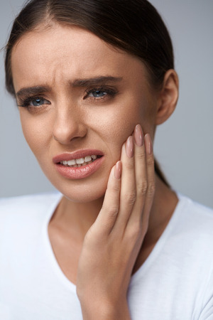a tooth are beautiful: Teeth Problem. Woman Feeling Tooth Pain. Closeup Of Beautiful Sad Girl Suffering From Strong Tooth Pain. Attractive Female Feeling Painful Toothache. Dental Health And Care Concept. High Resolution