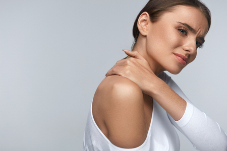shoulder problem: Pain In Body. Portrait Of Beautiful Young Woman Feeling Pain In Neck And Shoulders. Attractive Tired Exhausted Having Body Aches And Stress, Touching Painful Part. Health Care Concept. High Resolution