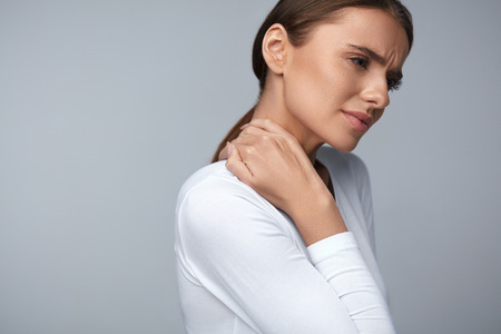 Tired Neck. Beautiful Young Woman Suffering From Neck Pain. Attractive Female Feeling Tired, Exhausted, Stressed. Girl Massaging Painful Neck With Hand. Body And Health Care Concept. High Resolution