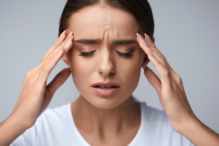 Health And Pain. Stressed Exhausted Young Woman Having Strong Tension Headache. Closeup Portrait Of Beautiful Sick Girl Suffering From Head Migraine, Feeling Pressure And Stress. High Resolution Image Stock Photo - 69606530
