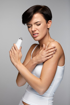 Body Pain. Beautiful Woman Feeling Muscle Pain In Arms, Applying Medical Pain Relief Cream On Arm. Girl Suffering From Painful Feeling, Putting Muscle, Joint Rub On Skin. Health Care. High Resolution
