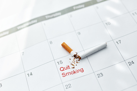 certain: Quit Smoking Cigarettes. Closeup Of Broken Cigarette Lying On Month Calendar, Certain Date Marked As Quit Day. Stop To Smoke Cigarettes, Anti-Smoking Concepts. High Resolution