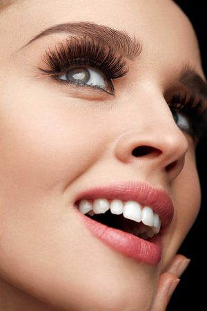 Woman Facial Makeup. Closeup Of Beautiful Smiling Female Face With Long Fake Eyelashes, Perfect Make-up. Happy Girl With Fresh Soft Skin, White Teeth And Perfect Smile. Beauty Concept. High Resolution