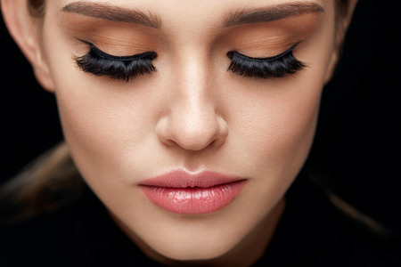 Long Black Eyelashes. Portrait Of Beautiful Woman Face With Closed Eyes And Thick Fake Eye Lashes. Closeup Of Sexy Girl With Smooth Skin, Fresh Facial Makeup. Beauty Cosmetics Concept. High Resolution