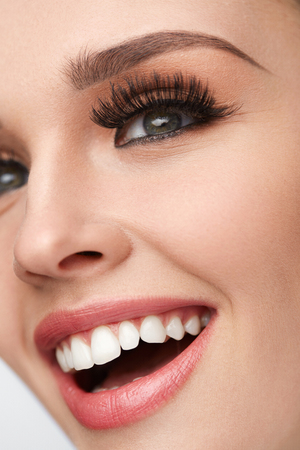 fake smile: Woman Facial Makeup. Closeup Of Beautiful Smiling Female Face With Long Fake Eyelashes, Perfect Make-up. Happy Girl With Fresh Soft Skin, White Teeth And Perfect Smile. Beauty Concept. High Resolution