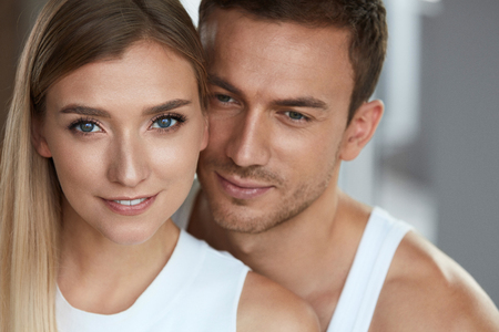 Beauty And Skin Care. Beautiful Couple In Love Closeup. Portrait Of Romantic Loving People, Happy Handsome Man And Smiling Woman With Fresh Soft Skin, Natural Face Makeup. Cosmetics. High Resolution