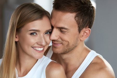 Love And Care. Closeup Happy Beautiful Lovely Couple. Smiling Woman With Fresh Soft Face Skin And Handsome Man Together. People In Romantic Relationships. Beauty And Skin Care Concept. High Resolution