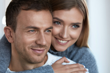 Beauty. Beautiful Couple In Love Embracing Together. Handsome Man And Lovely Woman With Smooth Soft Skin, Fresh Face Makeup Relaxing. Romantic Relationships, Winter Skin Care Concept. High Resolution Stock Photo