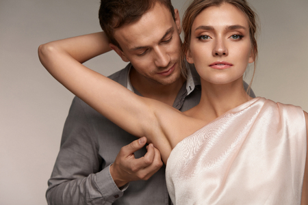 Body Hygiene. Handsome Man Caressing Beautiful Smiling Woman With Clean Soft Skin On Armpit. Male Gently Touching Sexy Girl Armpit. Female With Fresh Smooth Silky Skin. Couple In Love. High Resolution Standard-Bild