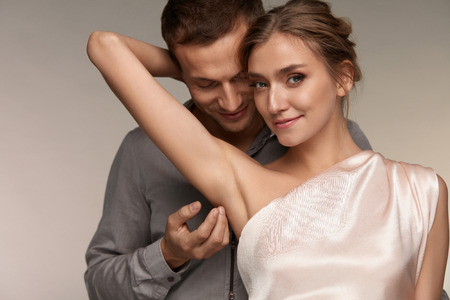 Body Hygiene. Handsome Man Caressing Beautiful Smiling Woman With Clean Soft Skin On Armpit. Male Gently Touching Sexy Girl Armpit. Female With Fresh Smooth Silky Skin. Couple In Love. High Resolution Stock Photo