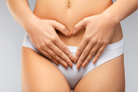Woman Body Care. Beautiful Healthy Girl With Fit Slim Body Touching Flat Tight Belly. ?lose-up Of Female In White Panties Holding Hands On Stomach. Feminine Health, Digestion Concept. High Resolution