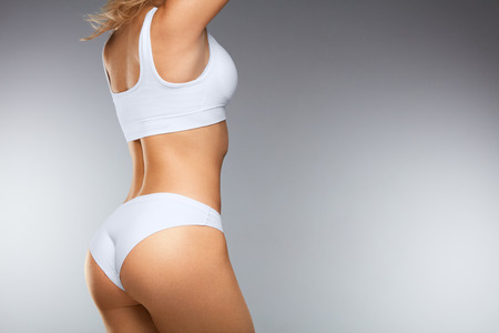 Beautiful Woman Body In Shape. ?loseup Healthy Girl With Fit Slim Body, Soft Skin And Firm Buttocks, Hips In White Bikini Panties. Female With Sexy Back, Tight Big Butt In Underwear. High Resolution