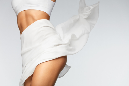 Beautiful Healthy Slim Body. Perfect Sexy Female Body In Shape With Flying Textile. ?loseup Of Fit Woman Body With Silky Soft Skin In White Bikini Underwear. Body Care, Health Concept. High Resolution Zdjęcie Seryjne