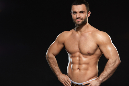 Bodybuilding Portrait Of Muscular Sexy Young Man With Healthy