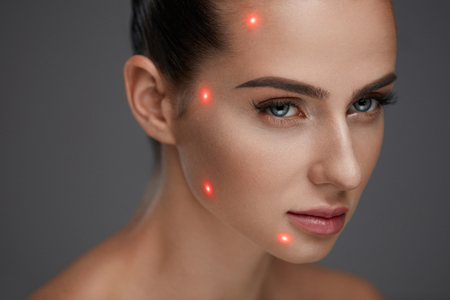 Cometology. Closeup Of Beautiful Sexy Woman Face With Smooth Skin And Perfect Makeup. Portrait Of Girl Before Plastic Surgery With Laser Marks On Facial Skin. Cosmetic Treatment. High Resolution Stock Photo