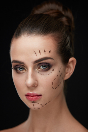 Beauty. Closeup Of Beautiful Sexy Woman With Soft Skin And Black Surgical Lines On Face. Portrait Of Healthy Young Female Model With Perfect Makeup Before Plastic Surgery Operation. High Resolution Banco de Imagens