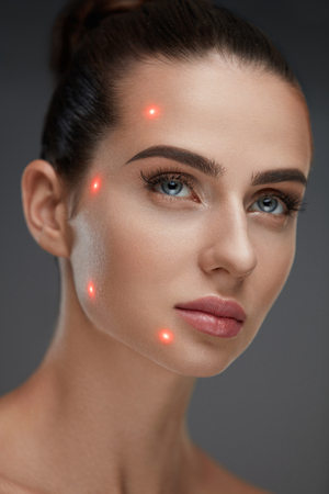 Cometology. Closeup Of Beautiful Sexy Woman Face With Smooth Skin And Perfect Makeup. Portrait Of Girl Before Plastic Surgery With Laser Marks On Facial Skin. Cosmetic Treatment. High Resolution Stock fotó
