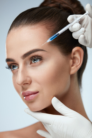 Beauty Face Injection. Portrait Of Beautiful Sexy Woman With Perfect Skin Getting Facial Lifting Procedure. Closeup Of Doctor Hands Doing Treatment With Hyaluronic Acid. Cosmetology. High Resolution