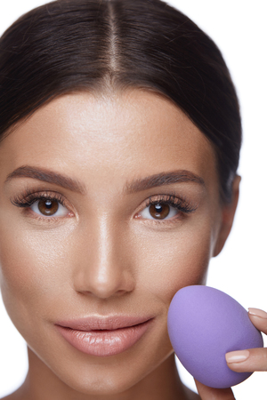 Beauty Makeup. Portrait Of Beautiful Sexy Woman Applying Foundation With Cosmetic Blender Sponge. Portrait Of Young Female With Pure Fresh Skin And Perfect Facial Makeup. Cosmetics. High Resolution Imagens