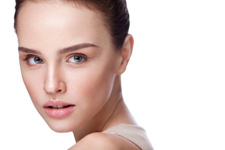 Woman Beauty. Portrait Of Attractive Young Female Model With Smooth Soft Skin And Natural Professional Makeup. Closeup Of Beautiful Girl Face On White Background. Facial Care. High Resolution Stock Photo - 76447012
