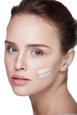 Facial Beauty Cosmetics. Attractive Young Woman With Clean Soft Smooth Skin And Fresh Professional Makeup. Closeup Of Beautiful Sexy Girl With Foundation Stripes On Face. Skin Care. High Resolution