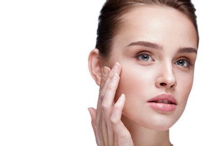 Woman Face Skin Care. Closeup Beautiful Sexy Woman With Perfect Professional Makeup Touching Her Smooth Soft Pure Clean Skin. Attractive Female Model Caressing Face. Beauty Cosmetics. High Resolution Stok Fotoğraf