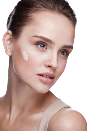 Woman Face Makeup. Closeup Of Beautiful Young Female Model With Perfect Natural Make-up On White Background. Portrait Of Sexy Girl With Foundation Cream Facial Skin Care Concept. High Resolution