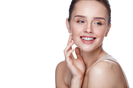 Beauty Cosmetics. Portrait Of Beautiful Smiling Woman Caressing Perfect Soft Skin. Close Up Of Attractive Young Female Model With Professional Natural Makeup. Facial Care. High Resolution